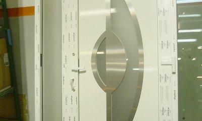 Drzwi wejściowe PVC z elementami aluminium i szkła